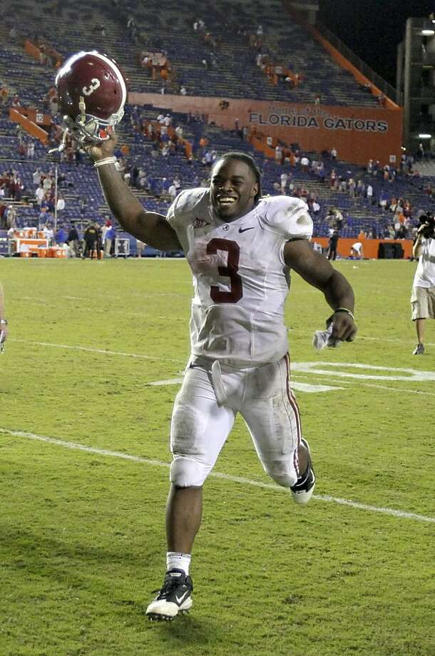 Alabama running back Trent Richardson celebrates as he runs off the field after Alabama defeated Florida 38-10 in an NCAA college football game Saturday, Oct. 1, 2011, in Gainesville, Fla. (AP Photo/John Raoux) Photo: John Raoux, AP