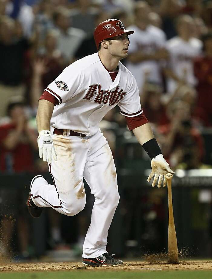 Arizona Diamondbacks' Paul Goldschmidt watches his grand slam in the fifth inning of Game 3 of baseball's National League division series against the Milwaukee Brewers on Tuesday, Oct. 4, 2011, in Phoenix. (AP Photo/Matt York) Photo: Matt York, AP