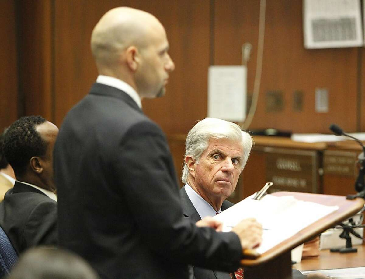 LOS ANGELES, CA - SEPTEMBER 30: Defense attorney J. Michael Flanigan watches co-counsel Naug Gourjian cross-examine paramedic Richard Senneff during day four of the Dr. Conrad Murray involuntary manslaughter trial at the Los Angeles Superior Court on September 30, 2011 in downtown Los Angeles, California. Murray is charged in the death of singer Michael Jackson who died of an overdose of prescription drugs, including propofol and lorazepam, in June of 2009. (Photo by Al Seib-Pool/Getty Images)