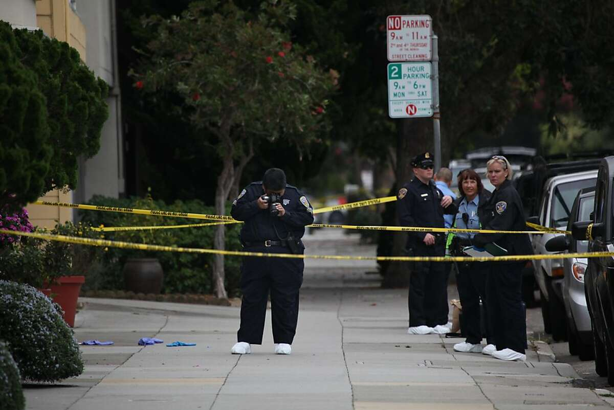 Police work as they investigate the scene where police shot and killed a knife-wielding man in the Richmond District this morning in San Francisco, Calif., on Monday, October 3, 2011. The man stabbed one elderly relative to death and wounded another, police said.