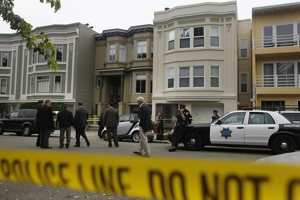 Police investigate at the scene where police shot and killed a knife-wielding man in the Richmond District this morning in San Francisco, Calif., on Monday, October 3, 2011. The man stabbed one elderly relative to death and wounded another, police said.