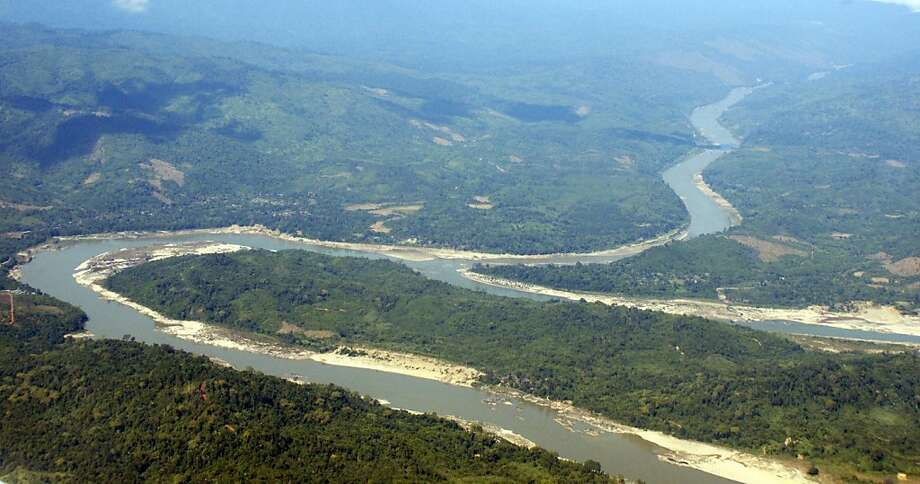 In this photo taken on Dec. 7, 2009, the Irrawaddy River runs through Kachin State, northern Myanmar. The country's President Thein Sein called Friday, Sept. 30, 2011 for a halt to construction of a controversial Chinese-backed hydroelectric dam on the river in the state, a move that had been called for by the country's pro-democracy movement. (AP Photo/Khin Maung Win) Photo: Khin Maung Win, AP