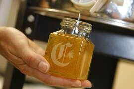 A jar is filled with honey in the San Francisco Chronicle test kitchen, in San Francisco, Calif. on Monday, Sept. 12, 2011.