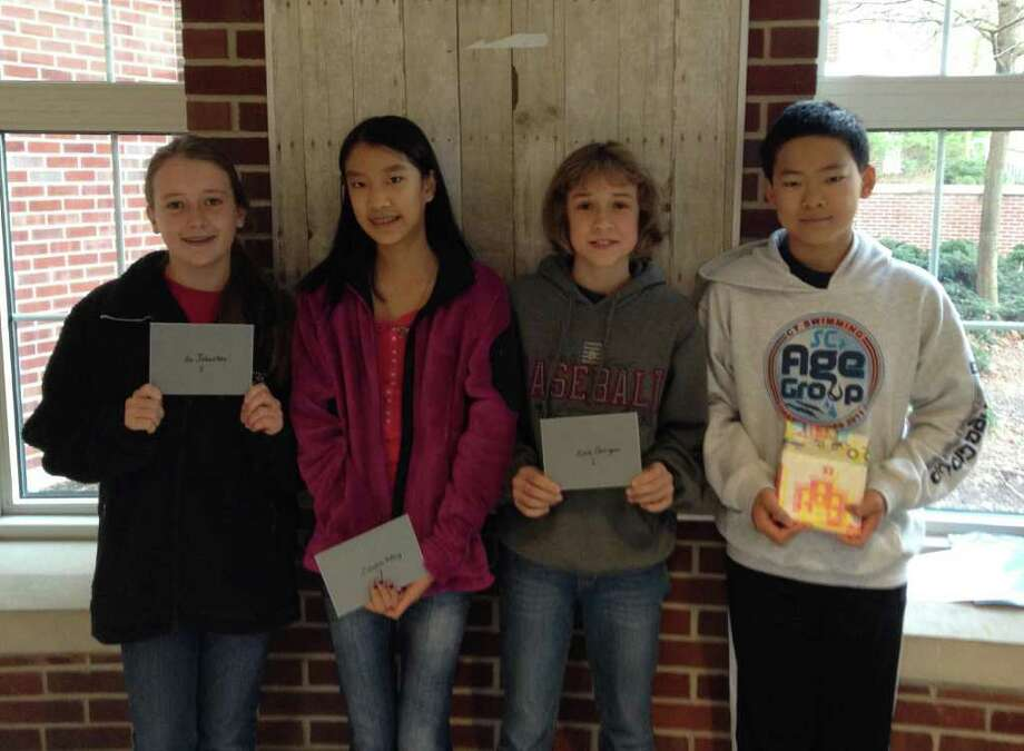 Pictured are Post-It winners Isa Johnsten for eighth grade, Candice Wang for seventh grade, Erin Corrigan for sixth grade and Eric Liu for foreign language. Photo: Contributed Photo