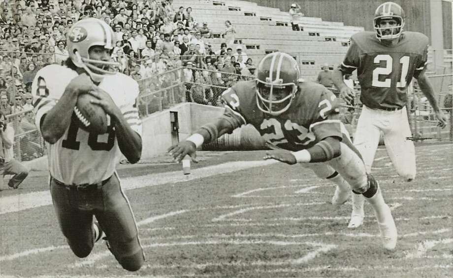 washington_1.JPG September 24, 1973- Gene Washington, left, dives for a pass in the Denver end zone during a 1973 San Francisco 49ers game against the Denver Broncos. Defending  for the Broncos was Maurice Taylor (23) and Randy Montgomery (21). /  Ran on: 02-14-2010 Photo caption Dummy text goes here. Dummy text goes here. Dummy text goes here. Dummy text goes here. Dummy text goes here. Dummy text goes here. Dummy text goes here. Dummy text goes here.