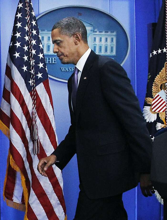 FILE - In this Oct. 29, 2010, file photo President Barack Obama leaves the White House press briefing room after saying the U.S. is committed to disrupting al-Qaida in Yemen. The drone strike in Yemen Friday killed the radical cleric Anwar Al-Awlaki, al-Qaida bomb-maker Ibrahim al-Asiri and Samir Khan, the editor of the al-Qaida propaganda magazine Inspire, making the attack perhaps the single most successful drone strike ever. Obama's approval rating on terrorism was higher than on any other issue, according to an Associated Press-GfK poll conducted in late August. It showed that 60 percent of those surveyed approved of his handling of terrorism.  (AP Photo/Manuel Balce Ceneta, File) Photo: Manuel Balce Ceneta, AP