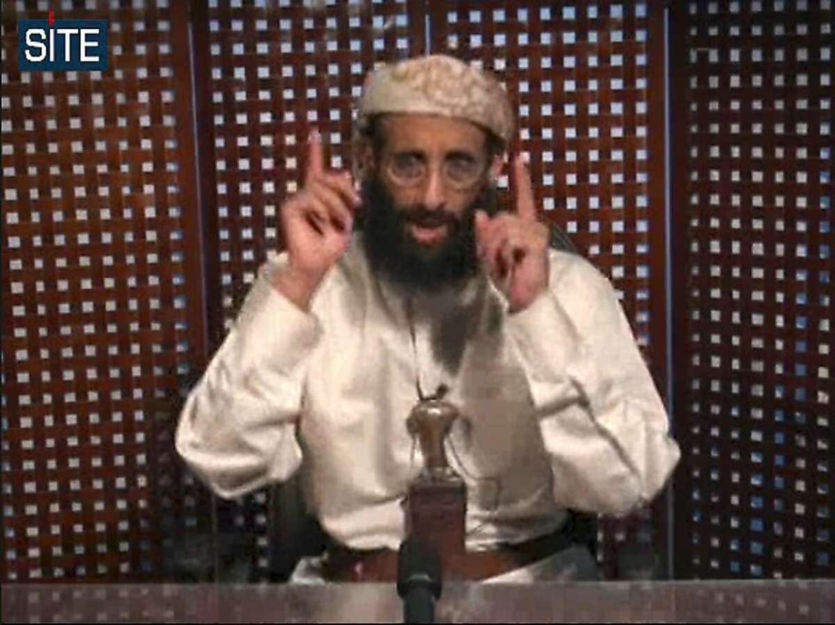 FILE - In this Nov. 8, 2010 file image taken from video and released by SITE Intelligence Group on Monday, Anwar al-Awlaki speaks in a video message posted on radical websites. A senior U.S. counterterrorism official says U.S. intelligence indicates that U.S.-born al-Qaida cleric Anwar al-Awlaki has been killed in Yemen. (AP Photo/SITE Intelligence Group, File) NO SALES Ran on: 10-01-2011 U.S.-born al Qaeda cleric Anwar al-Awlaki speaks in a video message posted on radical websites. He had become al Qaeda's top English-language propagandist, a Washington official said. Ran on: 10-01-2011 U.S.-born al Qaeda cleric Anwar al-Awlaki speaks in a video message posted on radical websites. Issuing sermons in English on jihad on the Internet, he drew recruits from all nations.