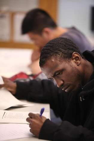 Baron DeShay of San Francisco works on economics class work at the 5 Keys ...