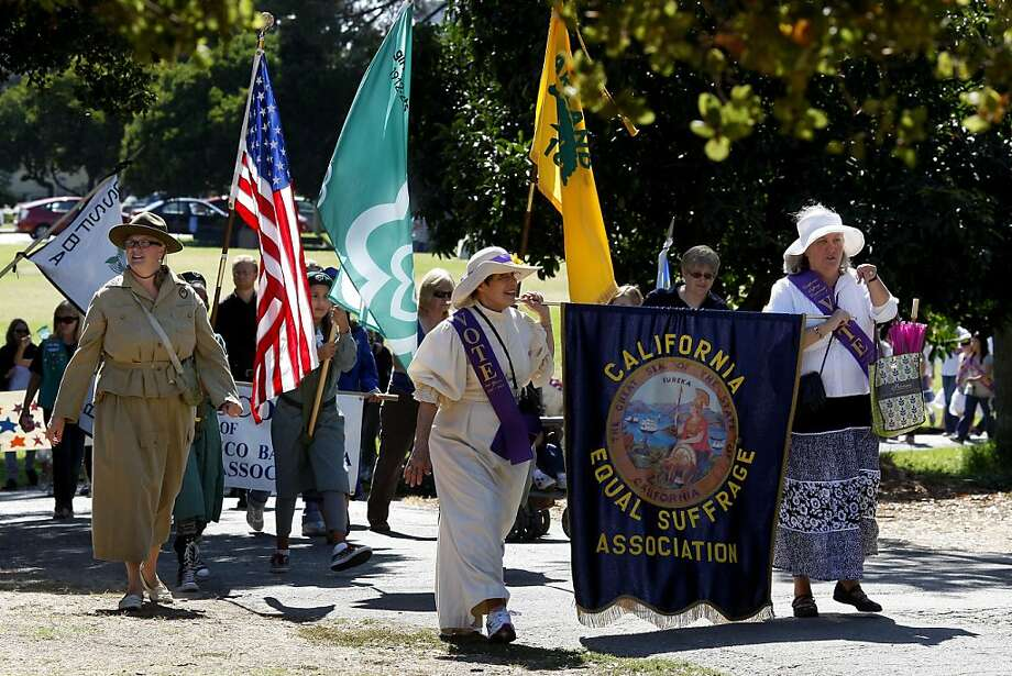 Marchers walked by Fairyland at Lakeside Park before marching down Grand Avenue. Several hundred women, children and their supporters held a rally and marched in Oakland, Calif. to remember the 100th anniversary of women getting the right to vote in California. Photo: Brant Ward, The Chronicle