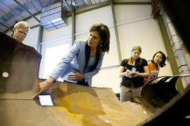 Debbie Hersman, Chairman of the National Transportation Safety Board, center, discusses with reporters the agency's investigation of the San Bruno gas pipleline explosion, the key piece of which she is standing next to, at the NTSB's training center and lab in Ashburn, Va., on Monday, August 29, 2011. The NTSB will hold a meeting to discuss the findings and probable cause of the accident tomorrow.