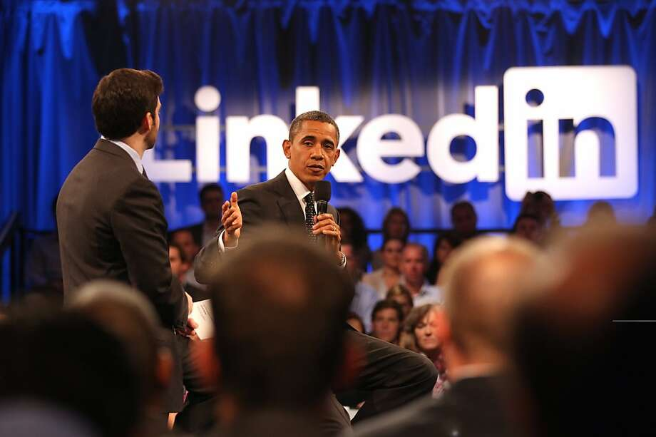 MOUNTAIN VIEW, CA - SEPTEMBER 26: LinkenIn Corp CEO Jeff Weiner (L), and U.S. President Barack Obama, (R), greets the audience during town hall meeting hosted by LinkedIn Corp. at the Computer History Museum on September 26, 2011 in Mountain View, California. The president used the opportunity to share his view on job creation and the current economy. (Photo by Stephen Lam/Getty Images) Photo: Stephen Lam, Getty Images