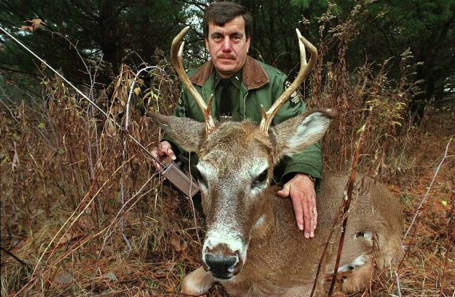 Lt. David Wayman of the state Department of Environmental Conservation is shown with a robotic deer used for poaching patrol in this 1997 photo. (Times Union archive) Photo: PAUL BUCKOWSKI / ALBANY TIMES UNION
