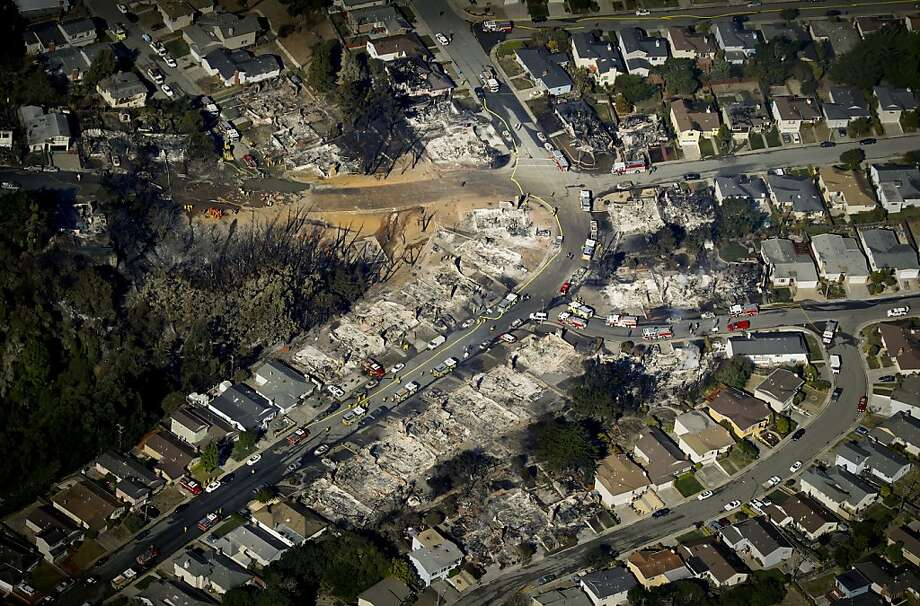 An aerial photograph shows the path of the destructive fire that started with an explosion in an underground natural gas pipeline. Photo: Brant Ward, The San Francisco Chronicle