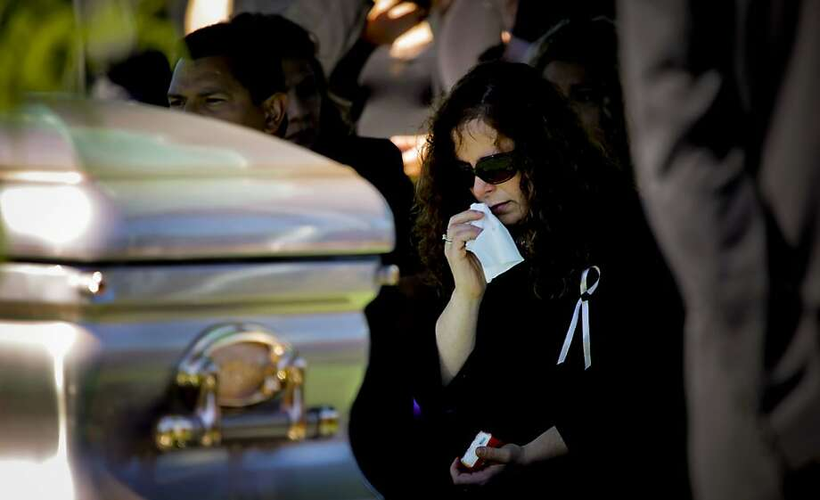 Rene Morales mourns at her daughter's, Jessica, funeral. Photo: Paul Chinn, The San Francisco Chronicle