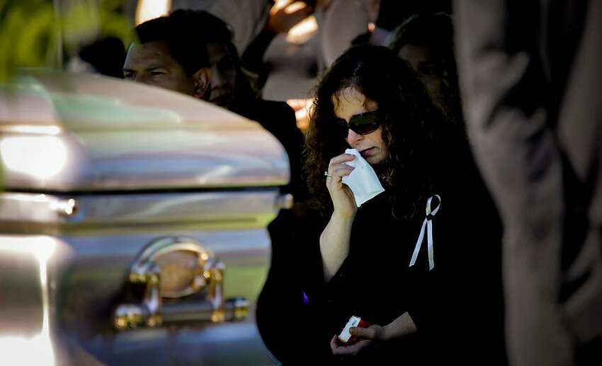 Rene Morales mourns at her daughter's, Jessica, funeral.