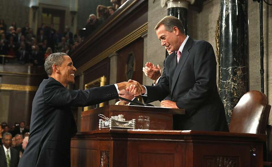 President Barack Obama arrives and shakes hands with House Speaker John Boehner of Ohio before addressing a joint session of Congress on Capitol Hill in Washington, Thursday, Sept. 8, 2011.  (AP Photo/Kevin Lamarque, POOL) Photo: Kevin Lamarque, AP