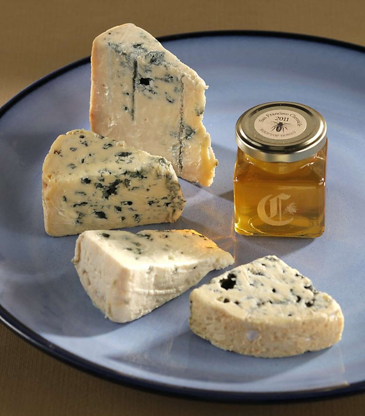 Counter clockwise from the top: 1. Mountain Gorganzola, Igor, 2. Bleu d'Auvergne, 3. Roquefort, Gabriel Coulet, 4. Fourme d'Ambert, L' Or Des Domes as seen in San Francisco, California, on Wednesday, September 21, 2011.