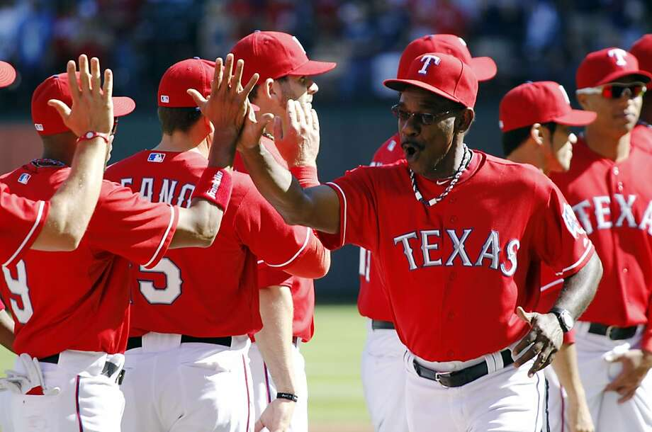 Texas Rangers manager Ron Washington (38) greets players before Game 1 of baseball's American League division series playoffs Friday, Sept. 30, 2011, in Arlington, Texas. (AP Photo/LM Otero) Photo: LM Otero, AP
