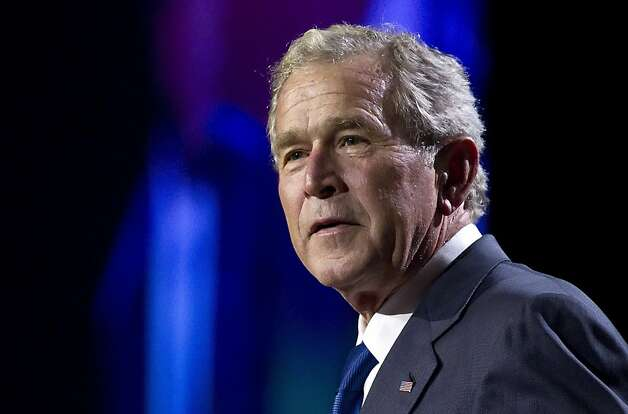 Former President George W. Bush delivers the keynote address at the annual Pennsylvania Chamber of Business and Industry dinner at the Hershey Lodge in Hershey, Pa., on Monday, Sept. 26, 2011. (AP Photo/The Patriot-News, Dan Gleiter) Photo: Dan Gleiter, AP