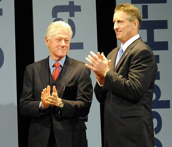Former President Bill Clinton and New York State Lt. Governor Robert Duffy applaud New York Gov. Andrew Cuomo during a New York Open for Business Statewide Conference at the Empire State Plaza Convention Center in Albany, N.Y., Tuesday, Sept. 27, 2011. (AP Photo/Hans Pennink) Photo: Hans Pennink, AP