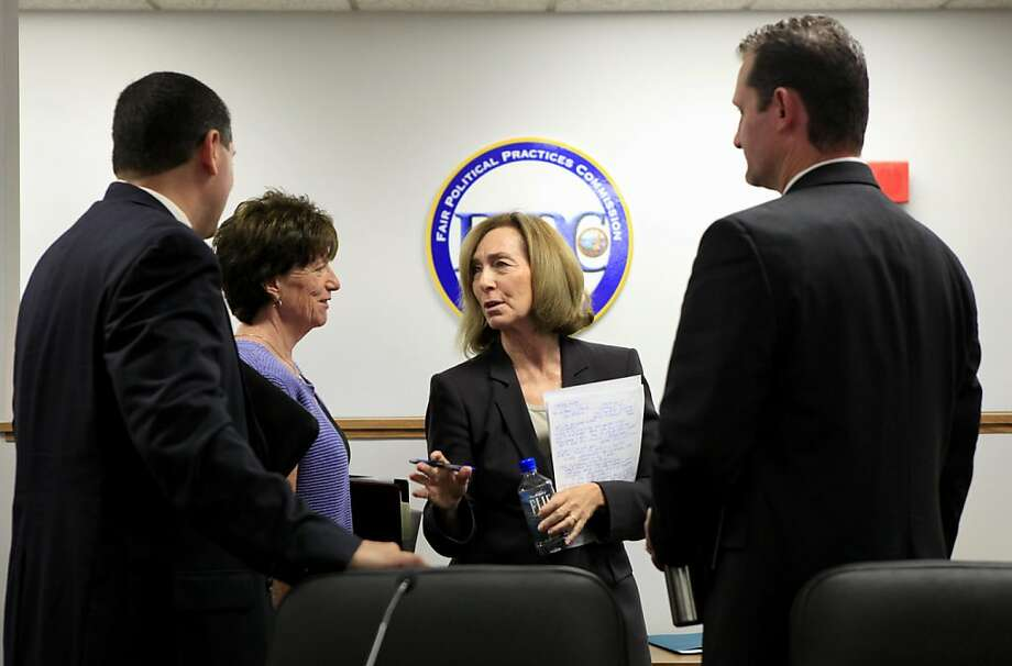 California Fair Political Practices Commission chair Ann Ravel, center, talks with staff members, Gary Winuk, left, Lynda Cassady, second from left, and Zackery Morazzini, right, after a meeting  concerning the hundreds of thousands of dollars in missing campaign funds in an alleged  embezzlement scheme by a former campaign treasurer, during a meeting of the California Fair Political Practices Commission in Sacramento, Calif., Friday, Sept. 30, 2011.  Federal prosecutors charged Democratic treasurer Kinde Durkee earlier this month with mail fraud and said she siphoned $700,000 from the campaign accounts of state Assemblyman Jose Solorio and others including U.S. Sen. Dianne Feinstein.(AP Photo/Rich Pedroncelli) Photo: Rich Pedroncelli, AP