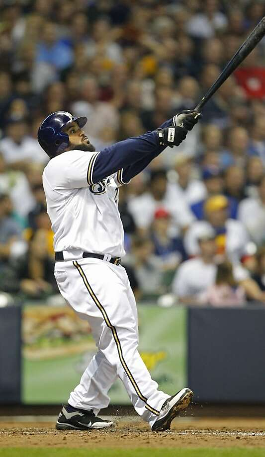 Milwaukee Brewers Prince Fielder watches his two-run home run during the fifth inning of a baseball game against the Pittsburgh Pirates Tuesday, Sept. 27, 2011, in Milwaukee. (AP Photo/Jeffrey Phelps) Photo: Jeffrey Phelps, AP