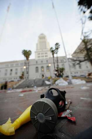 LOS ANGELES, CA - NOVEMBER 30: A gas mask belonging to a member of Occupy Los Angeles remains in the empty encampment at City Hall following the Los Angeles Police Department raid on November 30, 2011 in Los Angeles, California. Protesters remained on the City Hall lawn despite a deadline, set by Los Angeles Mayor Antonio Villaraigosa, to dismantle their campsite and leave the park which the city declared closed as of 12:01 am November 28th.  (Photo by Kevork Djansezian/Getty Images) Photo: Kevork Djansezian, Getty Images