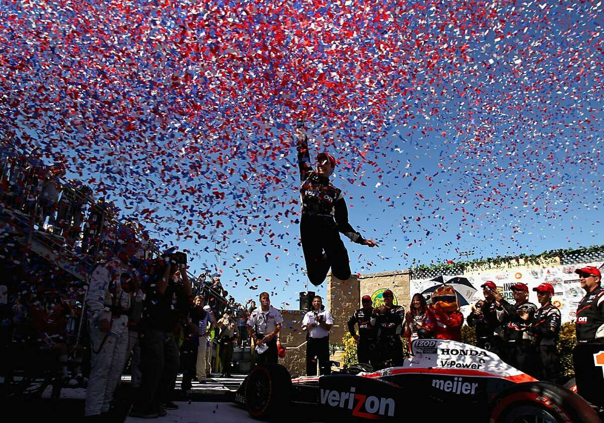 SONOMA, CA - AUGUST 28: Will Power of Australia, driver of the #12 Verizon Team Penske Dallara Honda, celebrates in the winners circle after he won the IZOD IndyCar Series Indy Grand Prix of Sonama race at Infineon Raceway on August 28, 2011 in Sonoma, California. (Photo by Ezra Shaw/Getty Images) *** BESTPIX ***
