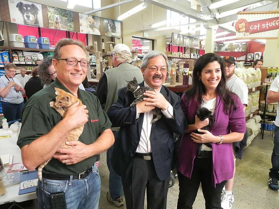 San Francisco Mayor Ed Lee (center) with Michael Levy, president of Pet Food Express, and Rebecca Katz, director of San Francisco Animal Care and Control, at the opening of the new adoption center at the Market Street location of Pet Food Express. Photo: Corey Stulce