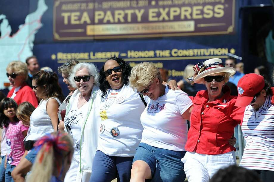 Ruth Ney (2nd from right) and others do a chorus line  at the Napa Valley Expo during the Tea Party Express launch on August 27, 2011. Photo: Susana Bates, Special To The Chronicle