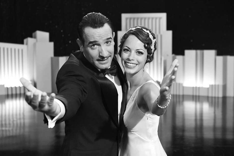 """In this film publicity image released by The Weinstein Company, Jean Dujardin portrays George Valentin, left, and Berenice Bejo portrays Peppy Miller in a scene from """"The Artist."""" The silent movie """"The Artist"""" and the doomsday drama """"Take Shelter"""" lead the Spirit Awards honoring independent films with five nominations each, including best picture. Winners will be announced Feb. 25, the day before the Academy Awards. (AP Photo/The Weinstein Company) Photo: AP"""