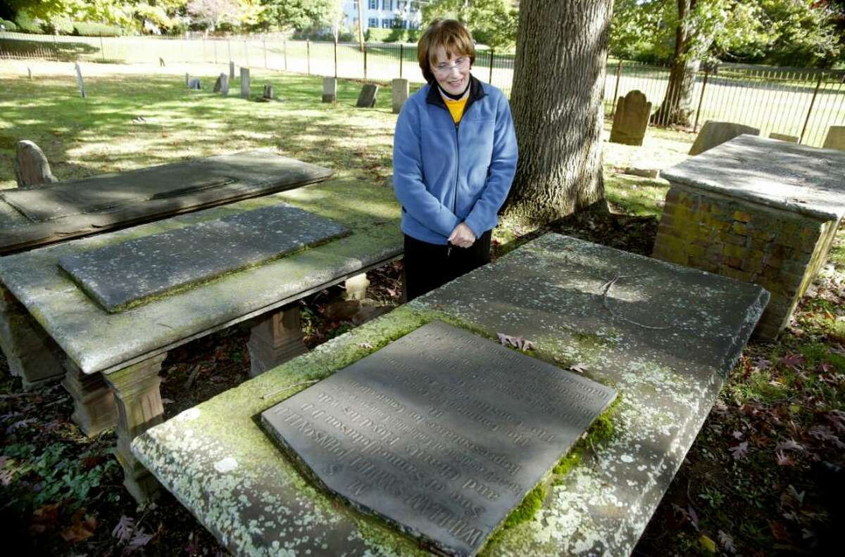 Christ Episcopal Church parishioner, Judy Kermay looks at the marker of William Samuel Johnson at the Christ Episcopal Church Burying Ground in Stratford, Monday, Oct. 19, 2009.