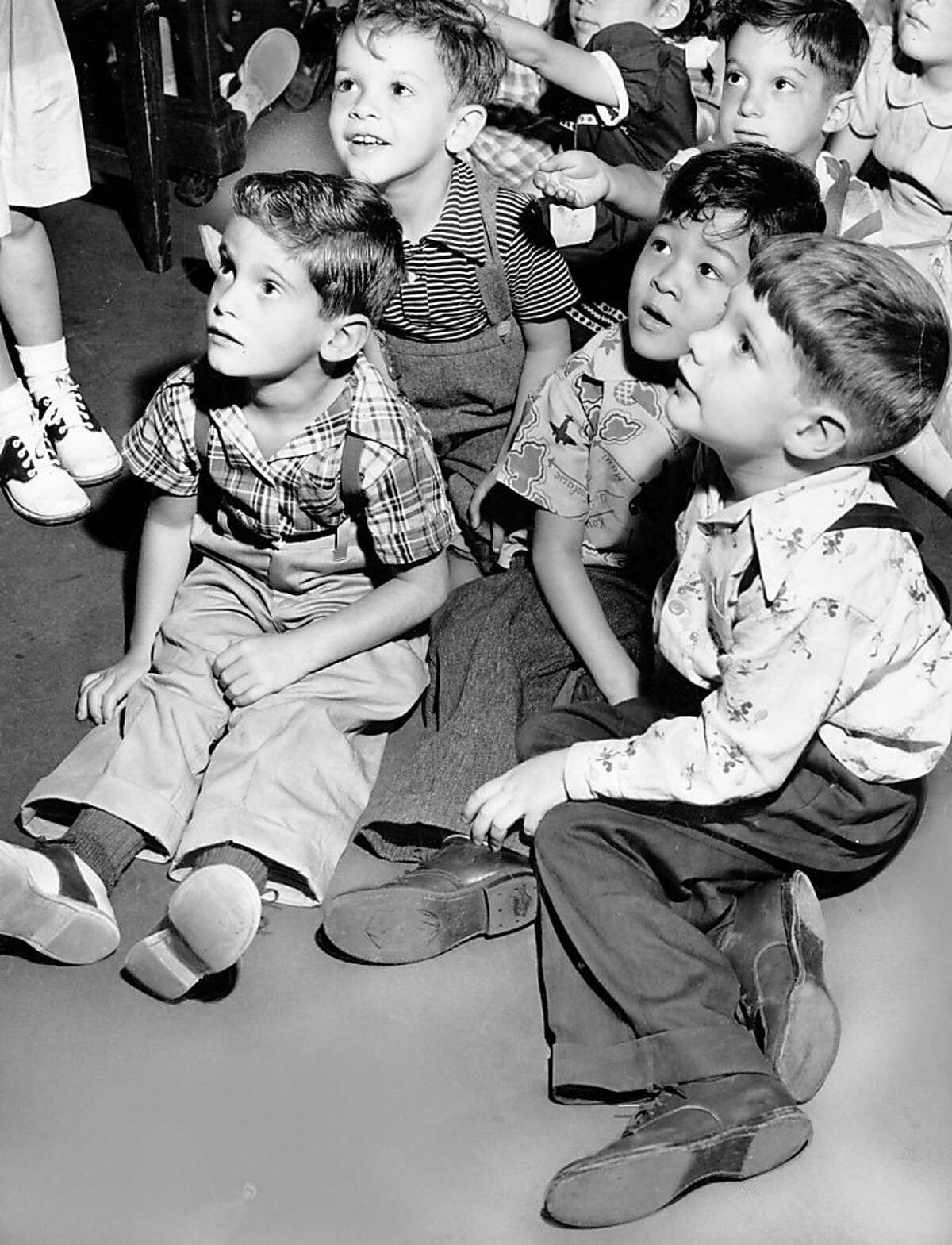 Children enjoying their first day of kindergarten at a Richmond District school in San Francisco. Sept. 8, 1949.