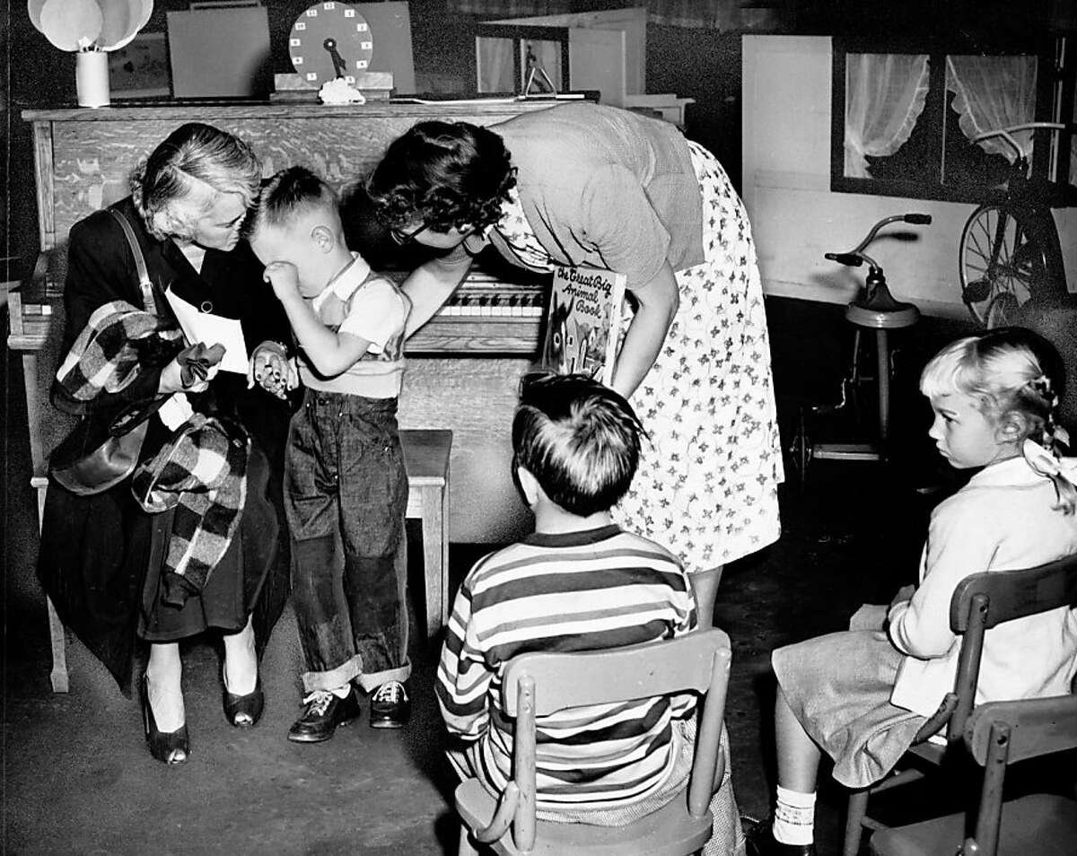 Bob Tarczy is consoled by his teacher during his first day of kindergarten. Sept. 7, 1950.