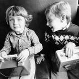 Ryan Ossa and James Barnes on the bus during their first day of kindergarten. Sept 7, 1983.