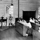 Wayne Warden wears the dunce cap at Douglas School in San Francisco. Kindergarten. April 24, 1950.