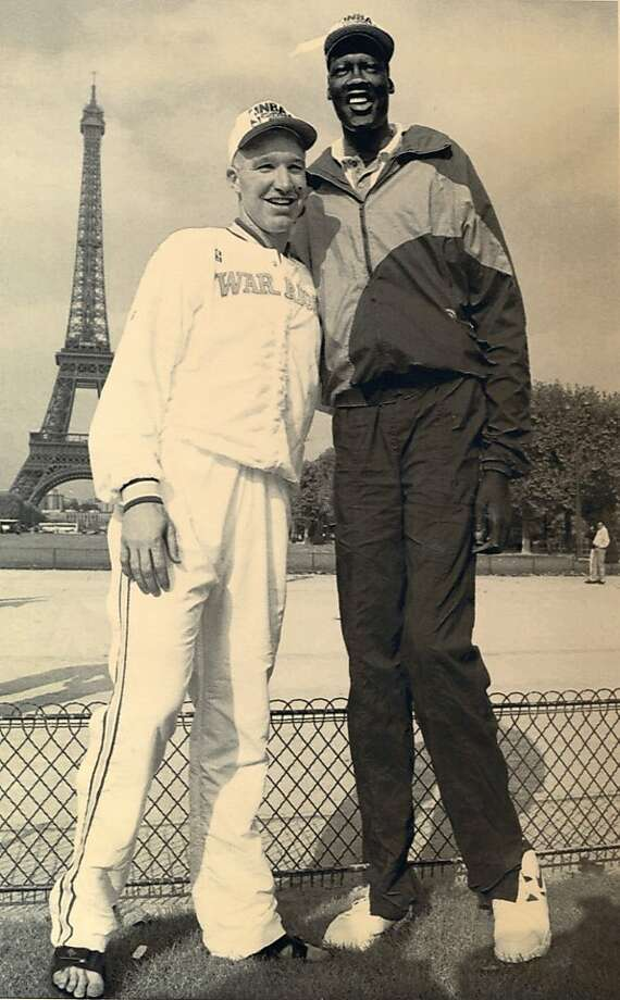Golden State Warriors guard Chris Mullin, left and Manute Bol pose near the Eiffel Tower in Paris Monday Oct 17, 1994, before Tuesday's game against the Hornets in Paris where the NBA begins a record 11 pre-season games outside the U.S..   AP Photo Michel Lipchitz Photo: Michel Lipchitz, 1994, AP