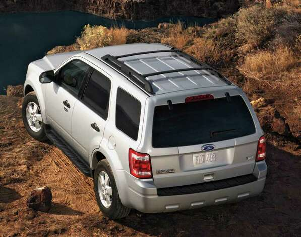 The Ford Escape, shown here in the 2012 model, is the best-selling compact crossover. It delivers sporty performance and great fuel economy. COURTESY OF FORD MOTOR CO. Photo: Ford Motor Co., COURTESY OF FORD MOTOR CO. / Ford