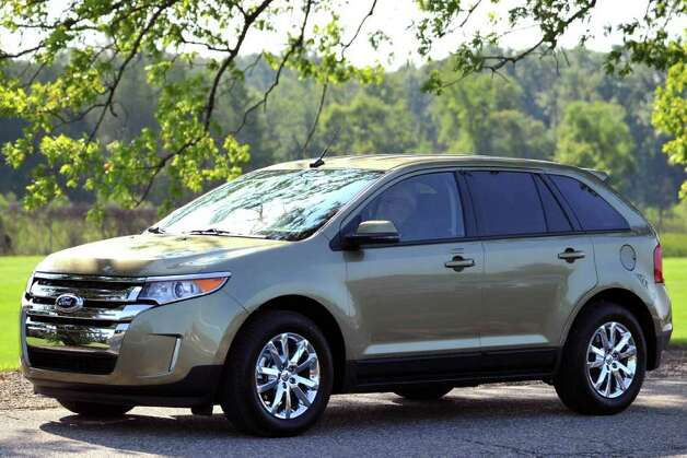 Restyled last year, the Ford Edge crossover delivers up to 30 mpg on the highway from its 240-horsepower, 2.0-liter EcoBoost four-cylinder engine. COURTESY OF FORD MOTOR CO. Photo: Ford Motor Co., COURTESY OF FORD MOTOR CO. / Ford