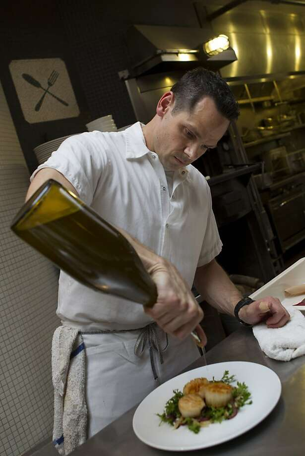 Executive Chef David Taylor prepares a dish of scallops with roasted fennel and Neapolitan chiles at A16 restaurant in San Francisco Thursday, November 17, 2011. The scallops will be one of the many courses offered on the restaurant's Christmas Eve Feast of the 7 Fishes, prix-fixe menu.  Ran on: 11-27-2011 Photo caption Dummy text goes here. Dummy text goes here. Dummy text goes here. Dummy text goes here. Dummy text goes here. Dummy text goes here. Dummy text goes here. Dummy text goes here.###Photo: SevenFishes011321401600SFC###Live Caption:Executive Chef David Taylor prepares a dish of scallops with roasted fennel and Neapolitan chiles at A16 restaurant in San Francisco Thursday, November 17, 2011. The scallops will be one of the many courses offered on the restaurant's Christmas Eve Feast of the 7 Fishes, prix-fixe menu.###Caption History:Executive Chef David Taylor prepares a dish of scallops with roasted fennel and Neapolitan chiles at A16 restaurant in San Francisco Thursday, November 17, 2011. The scallops will be one of the many courses offered on the restaurant's Christmas Eve Feast of the 7 Fishes, prix-fixe menu.###Notes:notes, cq's, etc###Special Instructions:**MANDATORY CREDIT FOR PHOTOG AND SF CHRONICLE-NO SALES-MAGS OUT-TV OUT-BAY AREA NEWS GROUP OUT** Photo: Erin Lubin, Special To The Chronicle