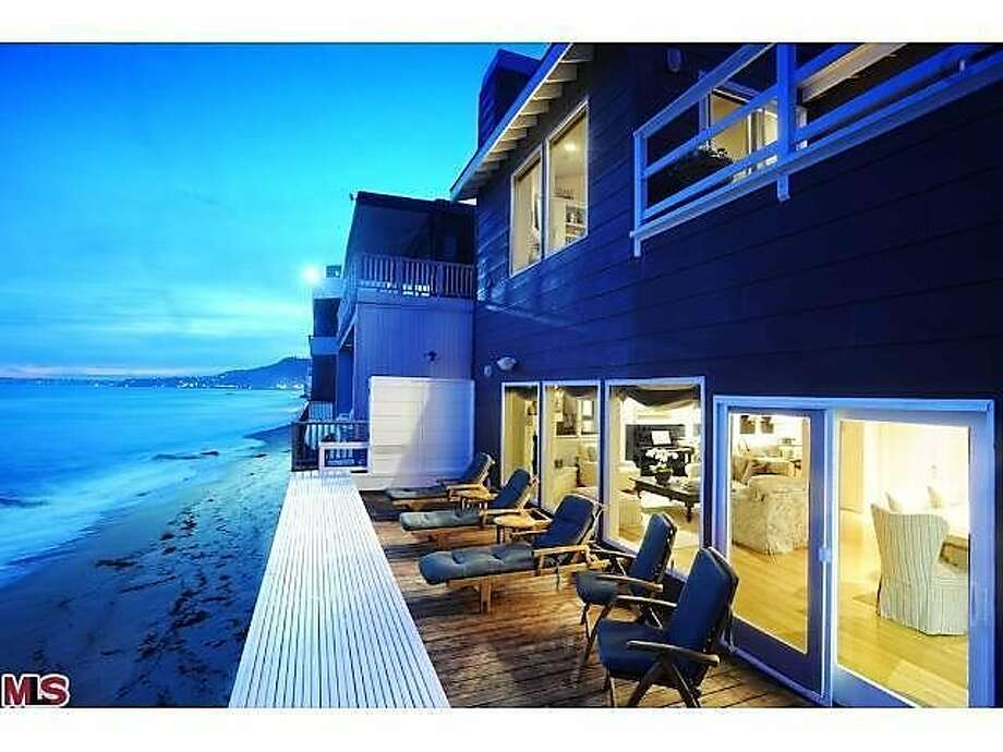 The deck at sunset, showing off the white water and beachfront view. Photo: Pritchett-Rapf & Associates