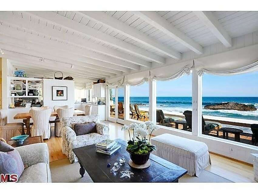 The living room, looking out onto the gorgeous beachfront view.