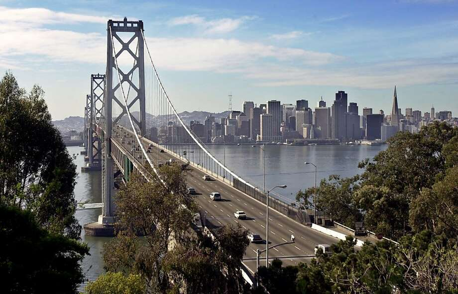 Light traffic on the San Francisco/Oakland Bay Bridge is shown in front of the San Francisco Skyline on a warm Sunday morning, Jan. 20, 2002. Photo was taken from Treasure Island in San Francisco.  (AP Photo/Paul Sakuma) Photo: Paul Sakuma