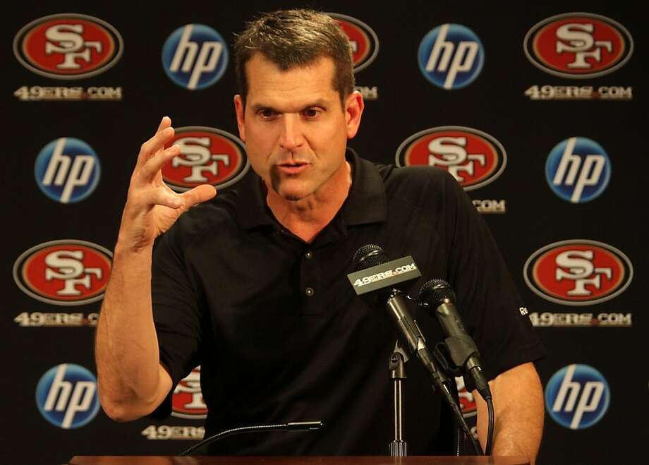 Forty-Niner Head Coach Jim Harbaugh answers a question during a news conference at the team's headquarters in Santa Clara on Monday. The NFL lockout is now over and players with be allowed into team facilities on Tuesday. Photo: Mathew Sumner, Special To The Chronicle