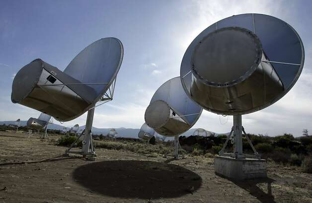In this Oct. 9, 2007 file photo, radio telescopes of the Allen Telescope Array are seen in Hat Creek, Calif. Astronomers at the SETI Institute in Northern California say a steep drop in state and federal funds has forced the shutdown of a key program to search for extraterrestrial life. Dozens of radio dishes that make up the Allen Telescope Array in the mountains of far Northern California have scanned deep space since 2007 for alien signals. Photo: Ben Margot, AP
