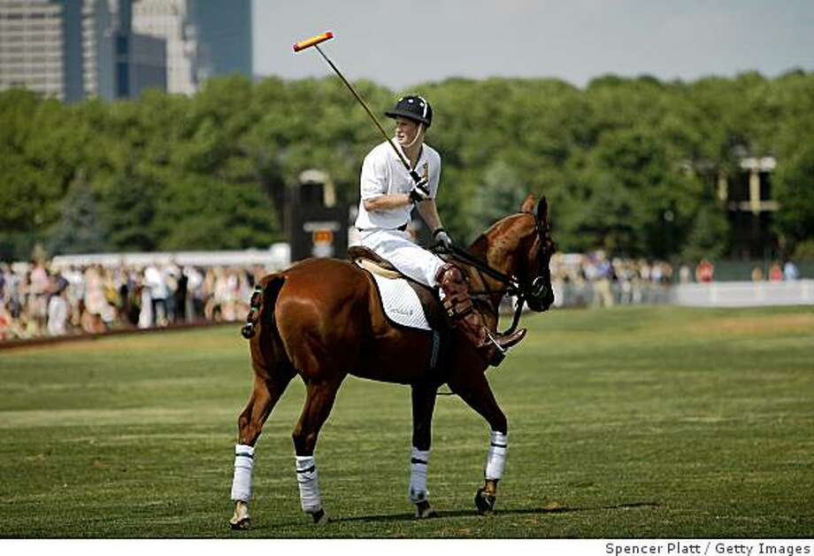 NEW YORK - MAY 30:  Britain's Prince Harry plays polo at the 2009 Veuve Clicquot Manhattan Polo Classic on Governors Island on May 30, 2009 in New York City. Coinciding with the opening of the Governors Island season and the 400th anniversary of New York, the polo match features Britain's Prince Harry who will play for the Sentebale team against the Black Watch team. All proceeds from the match will benefit American Friends of Sentebale, a charity that supports children in Losotho, Africa. The Prince is visiting the States for only the second time as the first was a private visit when he was a child.  (Photo by Spencer Platt/Getty Images) Photo: Spencer Platt, Getty Images