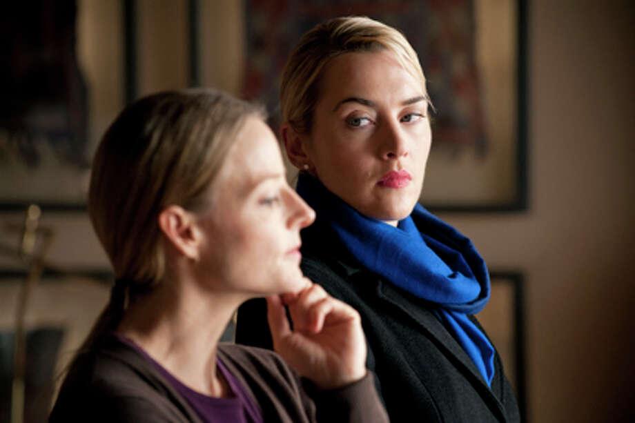 "(L-R) Jodie Foster as Penelope Longstreet and Kate Winslet as Nancy Cowan in ""Carnage."""