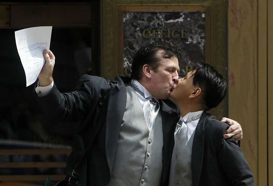 Patrick Plain, left, and Seong Man Hong, both of New York, celebrate after getting married at the City Clerk's office in New York Sunday, July 24, 2011. Hundreds of gay couples were expected to marry in New York and across the Empire State on the first day of same-sex marriage ceremonies. Photo: Jason DeCrow, AP