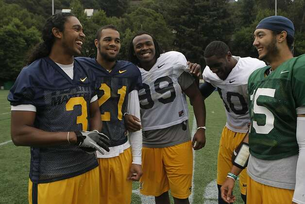 UC Berkeley teammates from North Carolina wide receiver Maurice Harris #3, wide receiver Keenan Allen #21, defensive end Gabe King #99, linebacker Chris McCain #40 , and quarterback Zach Maynard #15, stand together on Witter Rugby Field after practice in Berkely Calif.,  on August 27, 2011. Photo: Audrey Whitmeyer-Weathers, The Chronicle