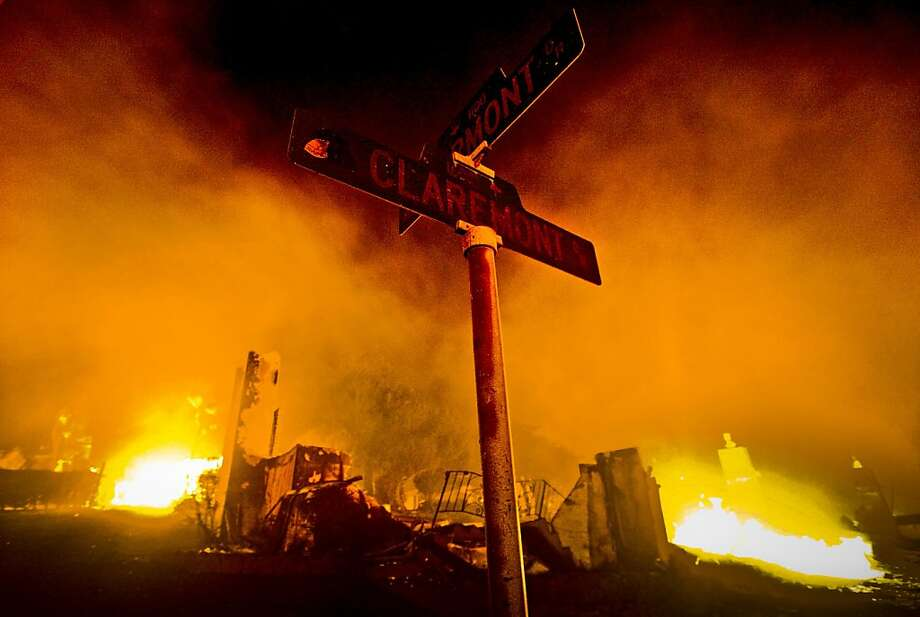 Homes burn at the intersection of Claremont and Fairmont in San Bruno, Calif., after a Pacific Gas & Electric Company gas pipeline ruptured and exploded on September 9, 2010, killing 8 people and destroying 38 homes. Photo: Jana Asenbrennerova, The San Francisco Chronicle